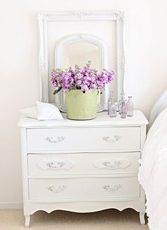 great display: painted dresser with vintage frames layered, bucket with flowers and old bottles...