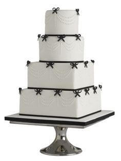 Add some pretty detail to your classic cake with tiny black bows around the edges.    From £1,125 for 200 portions, Peggy Porschen.