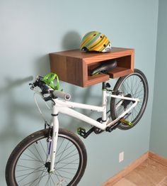 Does your dad like to pedal? Help him store his wheels in style with this space-saving wood bike-rack with shelf. via The Snug