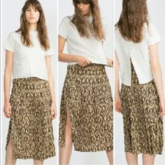 """Zara Python snakeskin pleated skirt Zara skirt with sexy and unexpected side slit. 30"""" from waist to hem. Waist 16"""" laying flat. 100% polyester for wrinkle free wear. Zara Skirts Midi"""