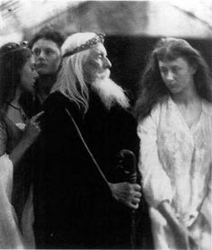 King Lear allotting his kingdom to his three daughters by Julia Margaret Cameron, 1872.  In this Shakespearian tableau, Cameron's husband, Charles Hay Cameron, poses as King Lear, while Alice Liddell and her sisters Edith and Lorina (of Alice in Wonderland fame) pose as Cordelia, Goneril, and Regan.