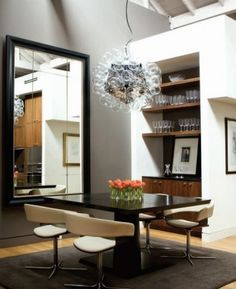 love everything (except maybe that chandelier thing).  Especially loving the huge mirror
