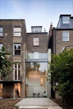 Bassett Road, Kensington & Chelsea is a contemporary renovation and remodelling of a Victorian town house by Paul+O Architects. It was awarded ?Best Use of Glass? for its 'innovative' double-height glazed extension. Photo: Fernando Guerra/Paul+O