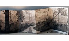 Aftermath by Catherine Nash. Sumi ink wash, accordion folded hand made abaca paper with gold and silver leafed cover, linen cording. Open 9.5 in. x 7 ft.