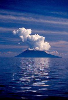 Manado Tua, Indonesia, in cloud.