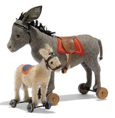 Google Image Result for http://www.christies.com/lotfinderimages/D53598/two_steiff_donkeys_on_wheels_one_grey_felt_black_boot_button_eyes_wool_d5359863h.jpg