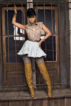 Lola Monroe skirt and thigh high boots, only a Mahogany woman could look this good, Gorgeous in front of mahogany doors!
