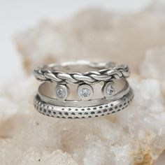 The three bands of this ring and the set diamonds represent that many times, good things, beautiful things, come in threes. Three little words; I love you.