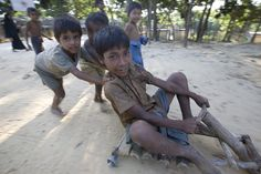 Rohingya refugees from Myanmar in Bangladesh. Boy play on a homemade scooter.  UNHCR/ S. Kritsanavarin
