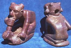"""Human Effigy Pipe - This pipe depicts a male figure crouching and smoking what appears to be (upon close inspection) a frog effigy pipe - 8.07"""" (20.5 cm) height - 14.37"""" (36.5 cm) length - Craig Mound, Spiro Mound Site - Eastern Oklahoma"""