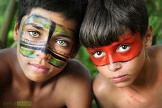 Two boys with painted faces in Sao Paulo. Brazil has more to offer than hosting the World Cup - Journey Latin America will create a trip of a lifetime for you.
