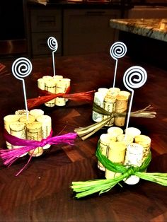 Invest in some wine and save the corks! Take 5 of the same size & hot glue vertically. Take rafetta ribbon & wrap around corks for color then stick a metal picture/paper holder in the middle cork.  Put name tags, menu items, or other creative identifiers.