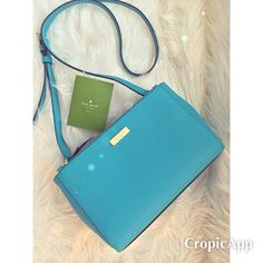 """Kate Spade turquoise double zip crossbody Brand new without tags. Beautiful Kate Spade turquoise leather crossbody. Features 2 zip closures and a spacious middle secured by a button clasp. Interior is a silky lining and can carry all the necessities and more. Strap is adjustable. Longest drop measures 24"""" and shortest is 22"""". This beauty is 10.5"""" wide and 6.5 high. Comes with care card. No dust bag.     REASONABLE OFFERS ❌NO Trades❗️  Non smoking home  Same/next day  kate spade Bags…"""