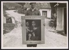 Citation: Unidentified G.I. holding a painting of the Madonna and child, at Altausse, Austria, 1945 / Thomas Carr Howe, photographer. Thomas...
