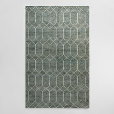 Handcrafted by artisans with a distressed and sheared pile for a vintage look, our exclusive rug features a geometric gate pattern with a striking dimension. Its low-profile construction and faded blue-green background make it easy to slip into any decor setting.