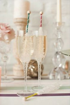 CHAMPAGNE & ROCK CANDY STICKS... i would drink more champagne this way