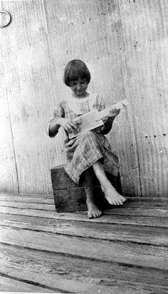 May Newman playing cigar box banjo she made: Palatka, Florida