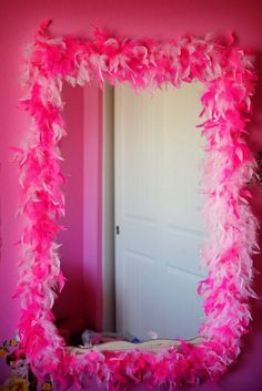 Feather Boa On Old Framed Mirror For Princess Dress Up Area