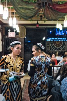 At Taste of Samarkand, the menu is written in Cyrillic and Latin script, with few details beyond each dish's name. The waitresses, wearing the traditional kuilak (long tunic) and lozim (pants) in a maze of colors, are patient and often poetic in their explanations. (Photo: An Rong Xu for The New York Times)