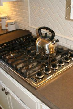traditional kitchen Cottage Kitchen - by Valerie Pedersen. Kitchen Remodel, Kitchen Design, House Design, Cottage Kitchen, Traditional Kitchen, Kitchen Finishes, Stove Backsplash, Tile Installation, Chevron Tile Pattern