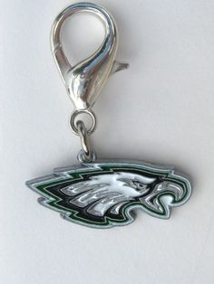 Officially Licensed NFL Team Charms Perfect gift for four-legged fans of the Philadelphia Eagles! These jewelry-quality charms are crafted from antiqued, lead-safe pewter, and are hand- enameled.   Size: 1 1/8 x 1 3/4 in.   Made in the USA