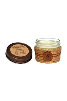A delightful cappuccino scent! A creamy espresso coffeehouse blend with whispers of dark chocolate honey and maple on a background of rich warm vanilla. Our candles are handmade hand decorated and wrapped in 100% natural jute.  Measures: 9 oz  Small Cappuccino Espresso Candle by Two Sisters Two Scents. Home & Gifts - Home Decor - Candles & Scents Ohio