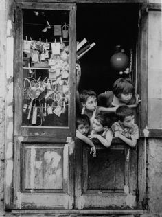Mario Cattaneo - Italy ca. 1957. You get the feeling the boy on the left was there first. The photo shows culture of   Italian forewardness.