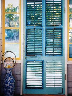 turquoise louvered doors...