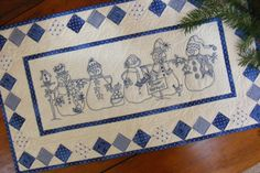 Picture of Snow Happens! Table Runner http://www.birdbraindesigns.net/products/786-embroidery-snowmen-bluework-christmas-winter.aspx