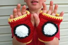 Fans of Iron Man or the Avengers are sure to love these fingerless Iron Man Gloves! Fast and easy to crochet, this crochet pattern is sure to save the day! Make a pair in any size by simply increasing your base chain to fit around your child's wrist.