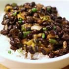 Spicy Black Beans. Try, substituting yellow onion and adding garlic?