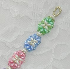 Spring is in the air!!!! So I was inspired to make this pretty spring-like bracelet...  I used Genuine Swarovski Crystals and SuperDuo beads with matching seed beads in pastel Spring colors. I did something different with the clasp....I used an 8mm Swarovski round Crystal AB on one end that fits into a seed bead loop on the other end. I made it easy enough to get the crystal through the loop but tight enough to stay put. The bracelet is about 7 3/4 inches long. As always, I can make it b...