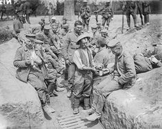 30 July 1916. Battle of Pozières Ridge 23 July - 3 Sept 1916. Water ( or Rum) is given to wounded British soldiers and German prisoners near Carnoy.
