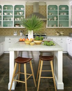 White cabinets with turquoise interiors and tan tile backsplash (don't like counter color w. backsplash color)