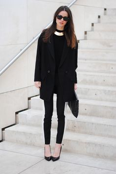 An all or mostly black ensemble is always chic for fall. Just add a luxe gold necklace to polish your outfit.