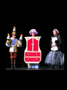 Disney's Beauty and the Beast Jr. October 2014 Lumiere (Sam Barnlund), Madame de la Grande Bouche (Isabel Forester), and Babette (Maddie Barnlund)