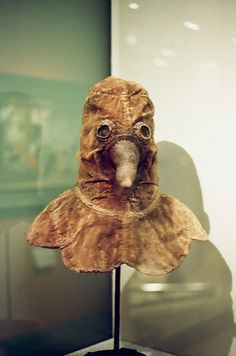 "GERMANY. Authentic plague doctor mask, presumably 14th century. // The ""beak"" would be stuffed with herbs to protect the doctor from the miasma that carried the plague."