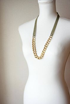 This necklace is made of a stunning gold tone vintage brass chain matched with an olive green Jacquard ribbon. It is light (37g), comfortable, doesnt clasp and is easy to put on over your head for effortless style. Please note that the chain in this necklace is vintage, with nice patina, and can appear tarnished. This is intentional in my designs and it makes your jewelry all the more unique and special.  The necklaces length is 301/4 - 77cm.   Bijou Caillou jewelry is beautifully packag...