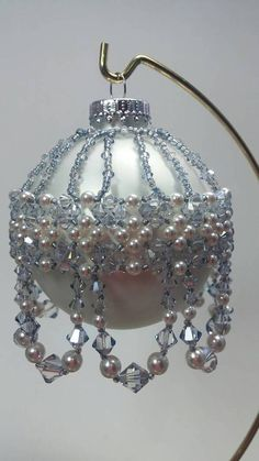 Beaded Christmas Ornament cover made with Swarovski Crystal blue shade and Swarovski white pearls with Colonial Grey Toho seed beads. Beaded Christmas Decorations, Crochet Christmas Ornaments, Handmade Christmas, Christmas Bulbs, Christmas Crafts, Beaded Ornament Covers, Beaded Ornaments, Snowman Ornaments, Beaded Jewelry Patterns