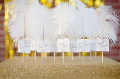 #gold #white #feather #great #gatsby #indoor #wedding #reception #stationery #escort #card #table #seating #chart #display