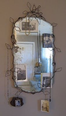 I formed this vine to support an old frameless chippy mirror.... ....and it doubles as a jewelry/photo/stuff holder.