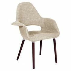 "Midcentury-inspired accent chair with light beige upholstery and exposed beech wood legs.  Product: ChairConstruction Material: Acrylic blend fabric and beechwoodColor: Light beigeFeatures:  Cut-out backFlared armsDimensions: 33.5"" H x 25.6"" W x 28.8"" D"