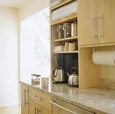 A tambour door hides a perky morning surprise -- a coffee center. The granite countertops are a striking feature, a hardy surface distinguished by rivers of rusty red. Stainless-steel accents also fit with the kitchen's contemporary feel.