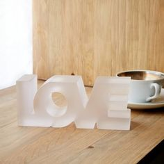 Spread the love with this clear frosted block word object, which functions as a paperweight or desk topper.