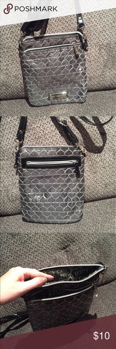 Betsey Johnson Metallic Crossbody Handbag Betsey Johnson Silver Metallic Crossbody Handbag. Black Patent adjustable strap. Small size perfect for on the go with a pop of color. Lightly worn, wear spot in the close up picture. Betsey Johnson Bags Crossbody Bags