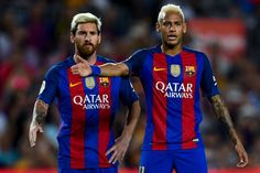 Lionel Messi (L) and Neymar Jr. of FC Barcelona reacts during the La Liga match…