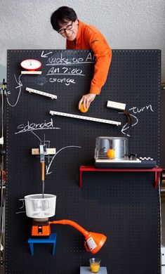 Makes Breakfast with Rube Goldberg Machine, Designed by Yuri Suzuki and Masa Kimura, the Breakfast Machine will make you a complete meal consisting of omelets, coffee, orange juice and toast with jam. The steps are annotated with chalk.