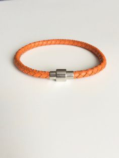 Orange Braided Leather Bracelet   Made to measure and ships the next day! Get yours while you can! They sell fast :) www.littlegemsbyluisa.etsy.com