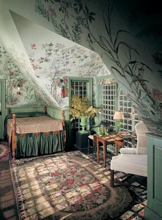 For a guest bedroom -- In a bedroom under the eaves at Beauport, Charles Sleepers' eclectic-fantasy-on-a-colonial-theme house in Gloucester, Massachusetts, a Chinoise tapestry paper hovers over the spool bed. (Photo: David Bohl/Historic New England)