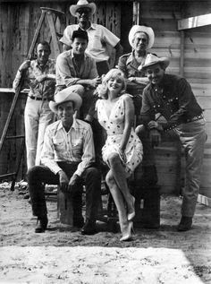 "Montgomery Clift, Marilyn Monroe, Clark Gable. Second row: Eli Wallach, John Huston. In back: producer Frank Taylor, Arthur Miller (on ladder). ""The Misfits"" (1961). Photo by Elliott Erwitt. USA. Reno, Nevada. 1960."